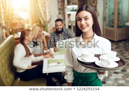 Young waitress with tray on white Stock photo © Elnur