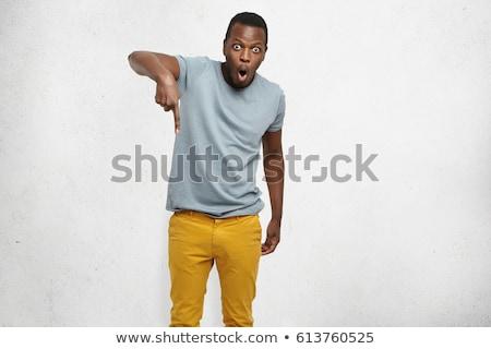 Hombre negro oscuro estudio mirando hacia abajo atractivo Foto stock © feedough
