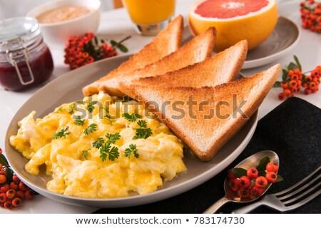 Roereieren toast tomaten schaal voedsel hout Stockfoto © Digifoodstock
