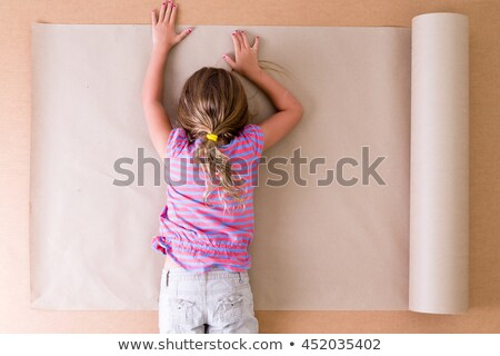 Depressed young artist lying on the paper Stock photo © ozgur
