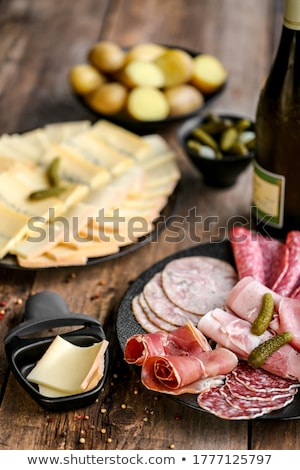 raclette cheese and assorted salami Stock photo © M-studio