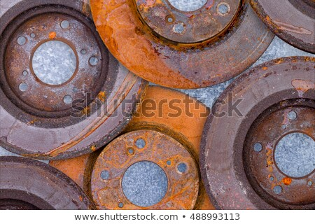 Layer of overlapping old rusty brake rotors Stock photo © ozgur