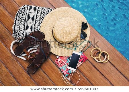 Widok z góry kobieta basen strój kąpielowy hat posiedzenia Zdjęcia stock © deandrobot