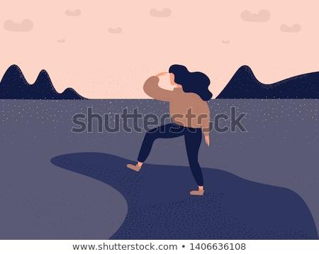 Silhouette woman on peak mountain Stock photo © Yongkiet