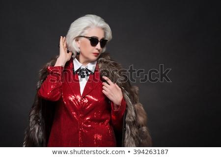 beauty rich woman with luxury jewellery looks like mature Stock photo © iordani