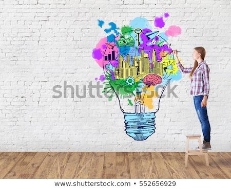 business idea drawn on brick wall stock photo © tashatuvango