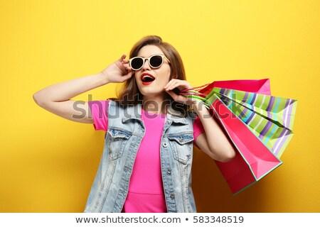 beautiful young woman in sunglasses, surprise sale Stock photo © studiostoks