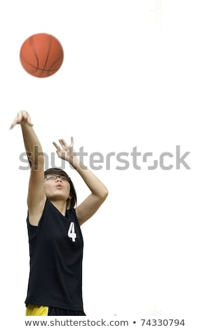Asian chinese teen girl throw basketball on white Stock photo © palangsi
