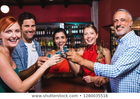 Portré barátok pirít tequila szemüveg éjszakai klub Stock fotó © wavebreak_media