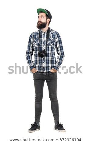 A Urban man wearing baseball cap over black background studio. Stock photo © Lopolo