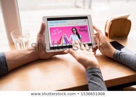 Main jeune femme touchpad ligne Photo stock © pressmaster