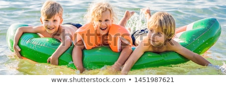 少年 海 インフレータブル マットレス バナー 長い ストックフォト © galitskaya