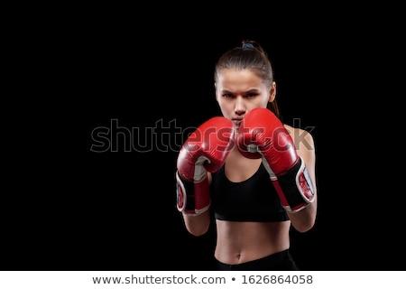 Jovem sério poderoso mulher luvas de boxe olhando Foto stock © pressmaster