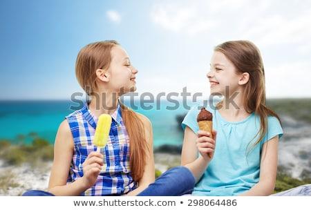 teenage girls or best friends at seaside in summer Stock photo © dolgachov