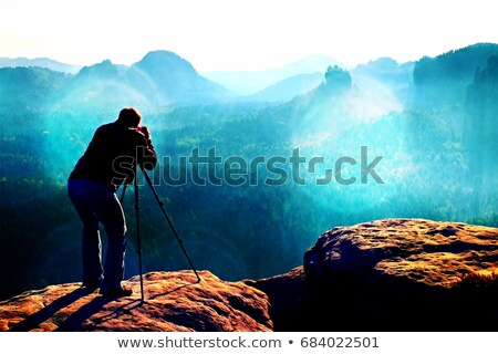 cameraman filming on cliff Stock photo © morrbyte