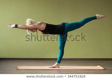 Woman Practicing Warrior Pose 3 Yoga Exercise Stock photo © rognar