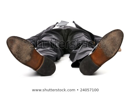 businessman laying down on white background stock photo © elenaphoto