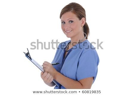 女性 看護 魅力的な 小さな 書く クリップボード ストックフォト © RandallReedPhoto