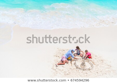 young girl making sandcastles on a beach stock photo © photography33