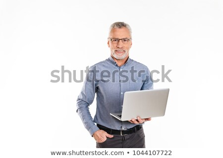 üzletember gesztikulál tart laptop izolált fehér Stock fotó © Qingwa