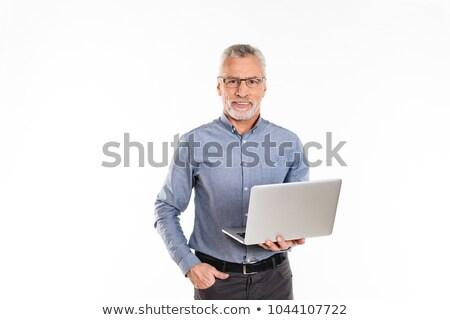 Stock photo: Businessman Gesturing, Holding Laptop Isolated on White Backgrou