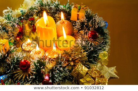 Christmas carol and burning candles over golden background Stock photo © AndreyKr