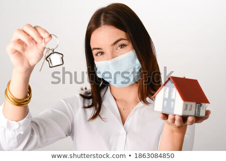 young beautiful business woman with house model   real estate s stock photo © hasloo