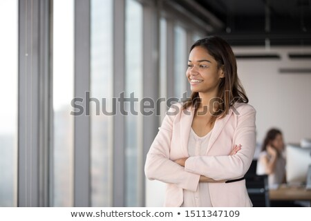happy business woman in the office resting and daydreaming stock photo © hasloo