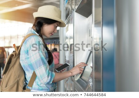 woman using ticket machine Stock photo © photography33