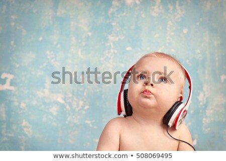 young laughing child with ear-phones listening to music Stock photo © gewoldi