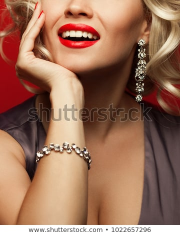 woman's hand with bracelet on breasts Stock photo © imarin