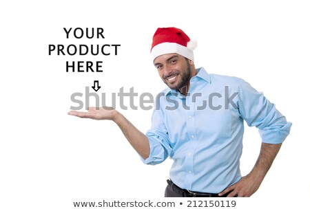 business man in santa hat holding blank white sign stock photo © scheriton