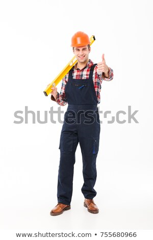 Man with spirit-level giving the thumbs-up Stock photo © photography33