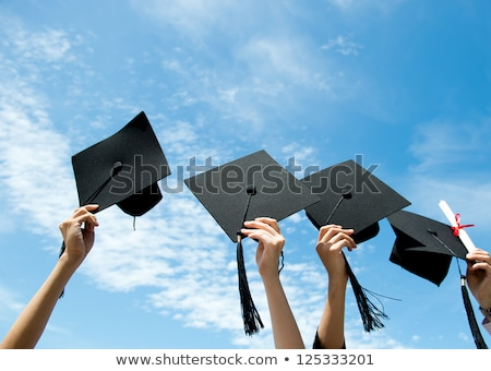 hand holding a graduation cap and diploma in the air Stock photo © experimental
