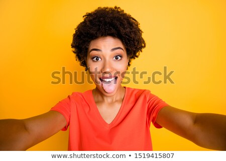 Woman sticking out her tongue Stock photo © stryjek
