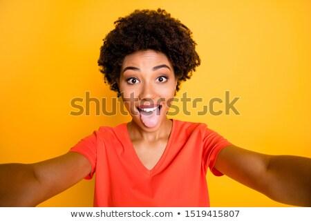 nő · ki · nyelv · szexi · nő · fekete · fürtös - stock fotó © stryjek