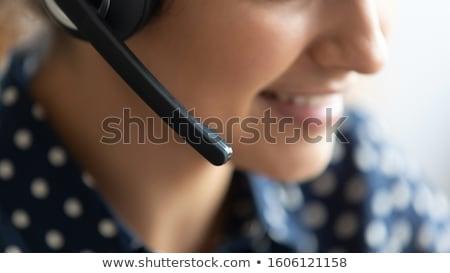Ventes représentant femme casque blanche Photo stock © wavebreak_media