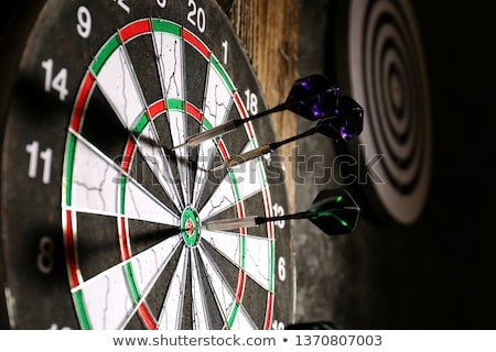 dart and dartboard stock photo © sidewaysdesign