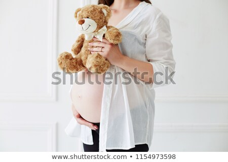 pregnant woman holding a big teddy bear stock photo © photography33