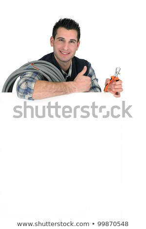 thumbs up from an electrician with a blank board stock photo © photography33
