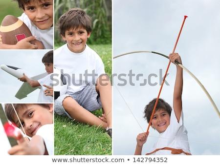 Montagem pequeno menino arco seta esportes Foto stock © photography33