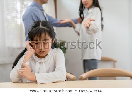 Smutne dziewczynka rodziców za kobieta Zdjęcia stock © wavebreak_media