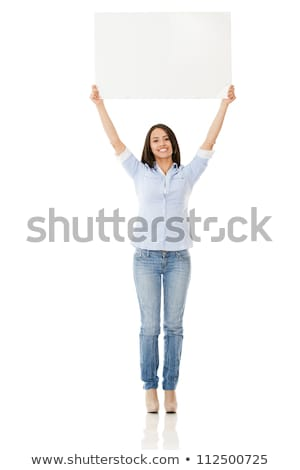 attractive woman holding up a poster   isolated stock photo © filipw
