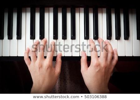 female hands on piano keyboard stock photo © dutourdumonde