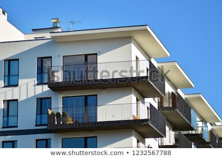 House with many balconies Stock photo © elxeneize
