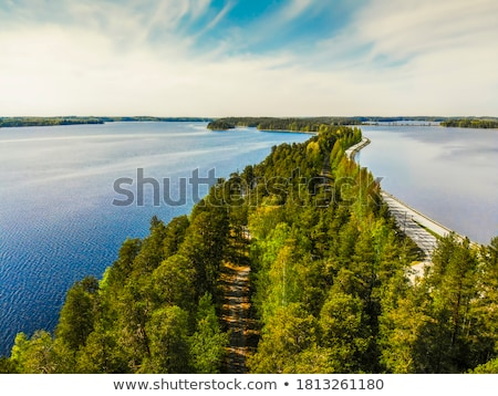 cottage in forest between lake and road stock photo © vetdoctor
