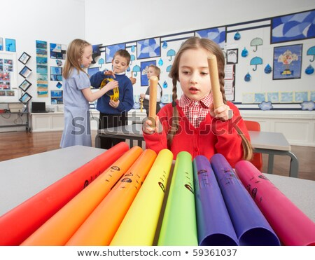 Group Of Primary Schoolchildren Having Music Lesson In Classroom Stock photo © monkey_business