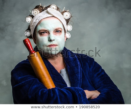 Angry housewife with rolling pin Stock photo © Nejron