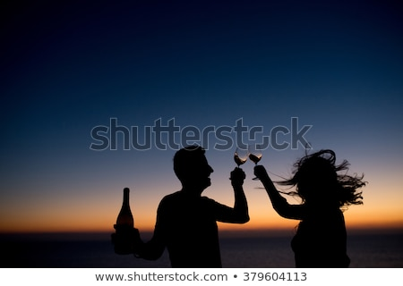 Uomo vetro bere sagome acqua ragazza Foto d'archivio © Slobelix