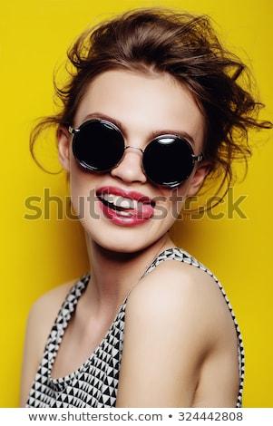 Moda kadın poz güneş gözlük stüdyo Stok fotoğraf © tobkatrina